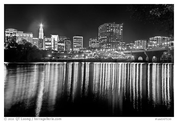 Skyline of Hartford reflected in Connecticut River at night. Hartford, Connecticut, USA (black and white)