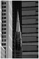 Church spire and modern buildings. Chicago, Illinois, USA ( black and white)