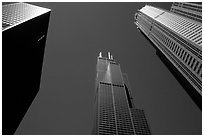 Upwards view of sears tower framed by other skyscrappers. Chicago, Illinois, USA ( black and white)