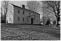 Historic house with early blooms in front yard, Sandwich. Cape Cod, Massachussets, USA ( black and white)