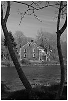Historic house next to pond, Sandwich. Cape Cod, Massachussets, USA ( black and white)