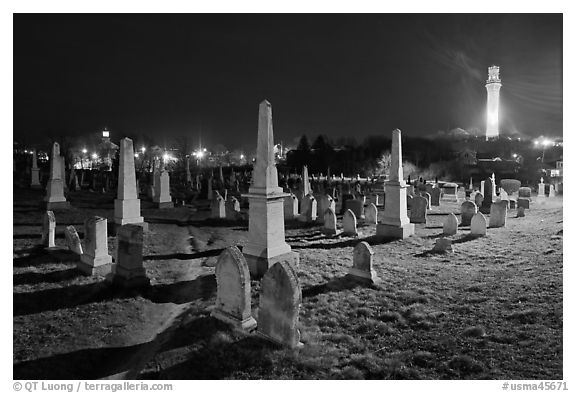 Cemetery and Pilgrim Monument at night, Provincetown. Cape Cod, Massachussets, USA (black and white)
