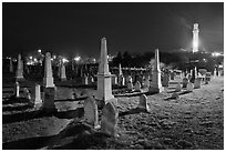 Cemetery and Pilgrim Monument at night, Provincetown. Cape Cod, Massachussets, USA ( black and white)