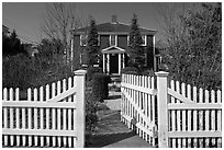 White picket fence and house, Provincetown. Cape Cod, Massachussets, USA ( black and white)
