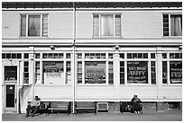 Men sitting in front of candy store, Provincetown. Cape Cod, Massachussets, USA (black and white)