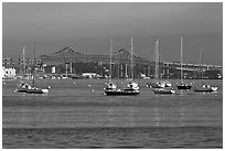 Harbor with anchored boats and bridge. Boston, Massachussets, USA ( black and white)
