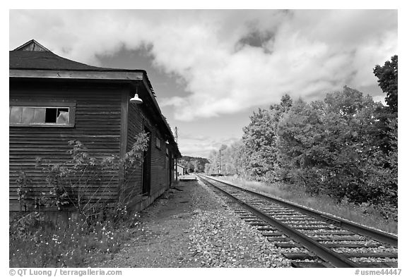 Railroad track and abandonned station, Greenville Junction. Maine, USA (black and white)