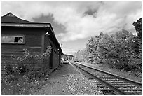 Railroad track and abandonned station, Greenville Junction. Maine, USA ( black and white)