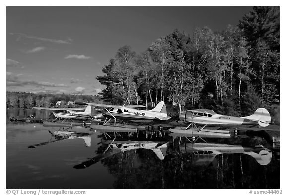 Floatplanes and reflections in Moosehead Lake  late afternoon, Greenville. Maine, USA (black and white)