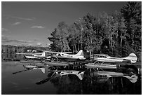 Floatplanes and reflections in Moosehead Lake  late afternoon, Greenville. Maine, USA ( black and white)