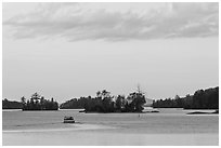 Motorboat and islets at sunset,  Moosehead Lake, Greenville. Maine, USA ( black and white)