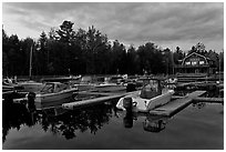 Boats in Beaver Cove Marina at dusk, Greenville. Maine, USA ( black and white)