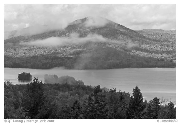 Autumn scenery with lake and clouds lifting up. Maine, USA (black and white)