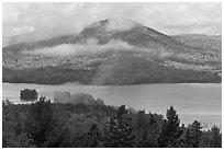 Autumn scenery with lake and clouds lifting up. Maine, USA ( black and white)