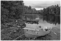 Cove and boat on shore of  Moosehead lake, Lily Bay State Park. Maine, USA ( black and white)