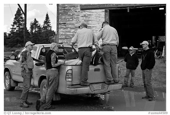 Game wardens check antler length of killed moose, Kokadjo. Maine, USA (black and white)