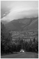 Truck on road below cloud-capped Katahdin. Maine, USA (black and white)