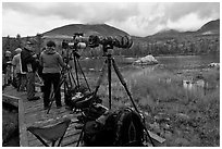 Cameras set up with telephoto lenses, Sandy Stream Pond. Baxter State Park, Maine, USA ( black and white)