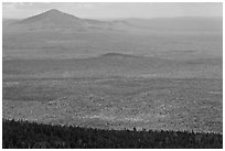 Distant hills rising above forested slopes in fall foliage. Baxter State Park, Maine, USA ( black and white)
