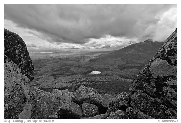 Mountain scenery in fall seen between boulders. Baxter State Park, Maine, USA (black and white)