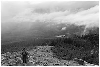 Hiker descending South Turner Mountain under the rain. Baxter State Park, Maine, USA ( black and white)