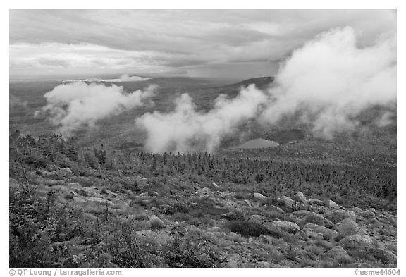 Autumn landscape with clouds hovering below mountains. Baxter State Park, Maine, USA (black and white)