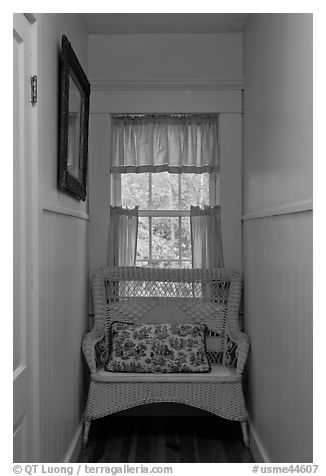 Corridor in inn with chair and window looking out to trees. Maine, USA (black and white)
