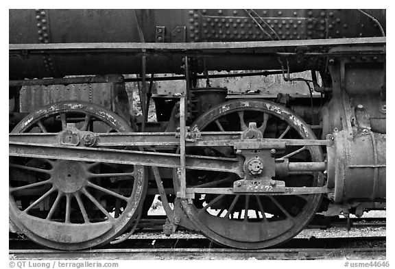 Wheels and pistons of vintage locomotive. Allagash Wilderness Waterway, Maine, USA (black and white)