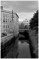Kenduskeag stream flows dowtown. Bangor, Maine, USA (black and white)