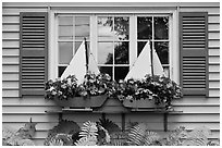 Window with flower pots shaped like sailboats. Bar Harbor, Maine, USA (black and white)