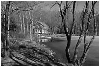 Lake, forest, and house in late winter. Maine, USA (black and white)