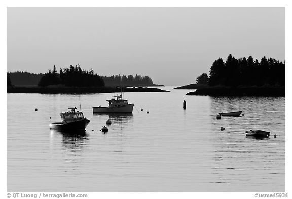 Boats and Penobscot Bay islets, sunrise. Stonington, Maine, USA (black and white)