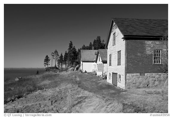 Historic houses and Penobscot Bay. Stonington, Maine, USA (black and white)