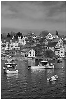 Lobster boats and houses on hillside. Stonington, Maine, USA (black and white)