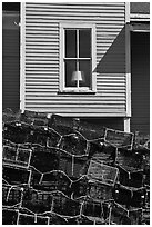 Lobster traps and window. Stonington, Maine, USA (black and white)