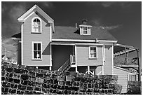 Lobster traps lined in front of house. Stonington, Maine, USA (black and white)