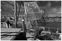 Lobsterman loading lobster traps. Stonington, Maine, USA (black and white)