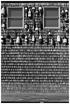 Facade decorated with buoys. Maine, USA ( black and white)