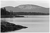 Frenchman Bay with snow-covered Cadillac Mountain in winter. Maine, USA ( black and white)