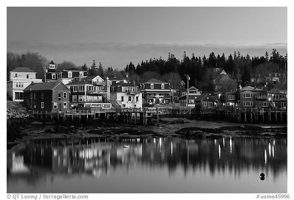 Harbor waterfront at dawn. Stonington, Maine, USA (black and white)