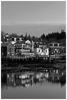 Houses with lights reflected in harbor. Stonington, Maine, USA ( black and white)