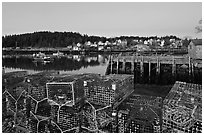 Lobster traps, pier, and village at dawn. Stonington, Maine, USA (black and white)