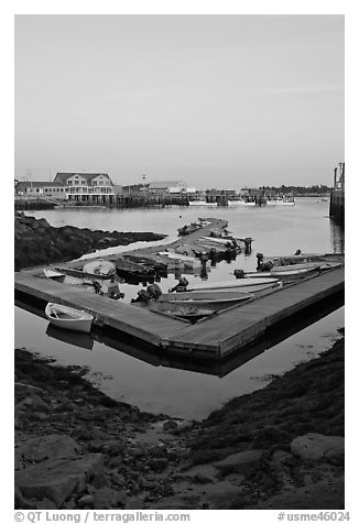 Small boats and harbor at sunset. Stonington, Maine, USA (black and white)