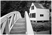 Wooden arched footbridge and house. Maine, USA ( black and white)