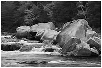 Whitewater of Wassatotaquoik Stream with boulders at Orin Falls. Katahdin Woods and Waters National Monument, Maine, USA ( black and white)