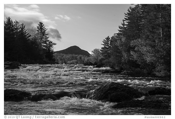 Haskell Rock Pitch cascades and Bald Mountain framed by trees in autumn foliage. Katahdin Woods and Waters National Monument, Maine, USA (black and white)