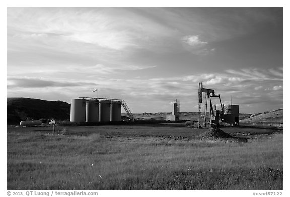 Oil pumpjack and tanks. North Dakota, USA (black and white)
