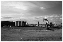 Oil pumpjack and tanks. North Dakota, USA ( black and white)