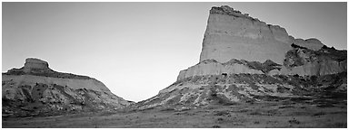Cliffs glowing red at dawn,  Scotts Bluff National Monument. South Dakota, USA (Panoramic black and white)
