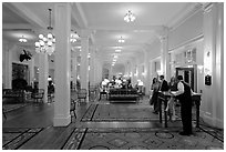 Guests entering Mount Washington hotel, Bretton Woods. New Hampshire, USA ( black and white)